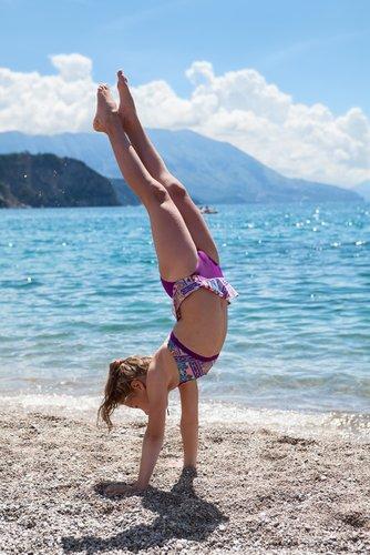 handstand-via-shutterstock-com