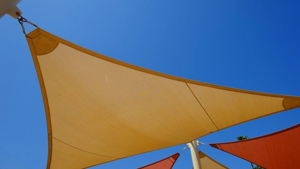 Schaduwdoek vs parasol welke past het best bij jou